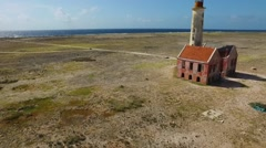 Aerial fly by of abandoned lighthouse on Klein Curacao Stock Footage