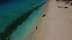 Aerial of kite surfer walking back onto the beach on Klein Curacao Stock Footage