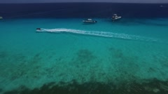 Aerial of jet ski driving in clear waters of Klein Curacao Stock Footage