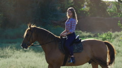 Beautiful girl riding a horse in slow motion Stock Footage