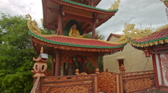 Closeup High Many Storey Pagoda with God Statue Stock Footage