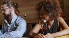 Ginger hipster man to make the acquaintance of black sexy girl at the bar Stock Footage