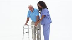 Nurse helping elderly patient with walker Stock Footage
