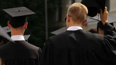 Group of young students graduating from university, people in academic dress Stock Footage