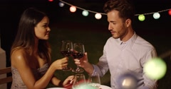 Romantic young couple enjoying dinner and wine Stock Footage