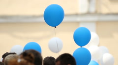 People holding colorful balloons to congratulate students at graduation ceremony Stock Footage
