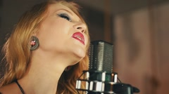 Portrait of vocalist with red lips perform at microphone. Retro style. Make up Stock Footage