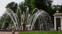 Shining fountain water jets, antique Eve sculpture in Peterhof, slow motion Stock Footage