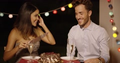 Elated young couple joking as they cut the cake Stock Footage
