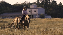 Beautiful girl riding a horse at ranch in slow motion Stock Footage