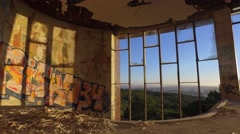 Sunrise city view inside an abandoned building gimbal 4k Arkistovideo