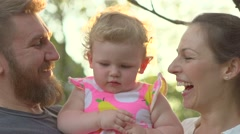 Happy family with little child outside. Stock Footage