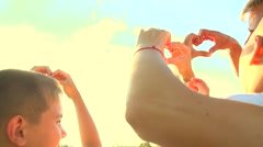 Beautiful Happy young familys making heart shape with their hands Stock Footage