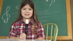 Portrait of young girl with recorder Stock Footage