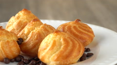 Delicious homemade pastry with chocolate chips on a white plate. Seamless Stock Footage