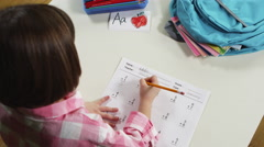 View of young girl doing mathematics Stock Footage