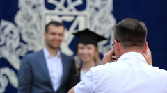 Photographer taking picture of students graduating from elite business school Stock Footage
