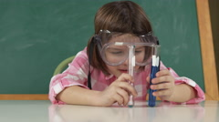 Young girl with safety goggles and test tube Stock Footage