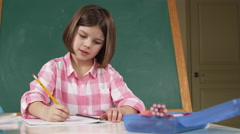 Young girl studying and doing homework Stock Footage