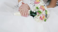 Delicate bride is holding marvelous bouquet. Golden ring. Wedding celebration Stock Footage