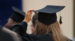 Young female adjusting academic cap on head, students ready for graduation Stock Footage