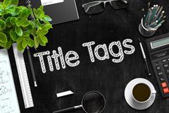 Title Tags on Black Chalkboard. 3D Rendering Stock Illustration