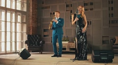 Jazz vocalist in glare dress and saxophonist perform on stage. Retro style Stock Footage