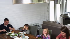 Family eating lunch outdoors on the patio Stock Footage