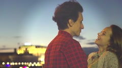 Beautiful happy young couple dating, looking onnight city, hugging. Stock Footage