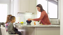 Family eating healthy snack in the kitchen Stock Footage