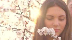 Beauty couple outdoors enjoying nature in blooming orchard. Stock Footage