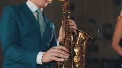 Saxophonist in blue suit play jazz on golden saxophone at stage. Music. Artist Stock Footage