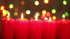 Burning red candle. Christmas background Stock Footage