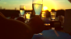 Group of people toasting and drinking champagne on the restaurant terrace Arkistovideo