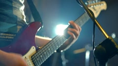 Man playing guitar, rock band rehearsal. Guitar closeup. Arkistovideo