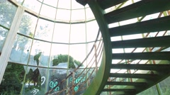 Abandoned staircase steel structure glass building steady shot gimbal 4k Stock Footage