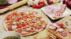 Ingredients to prepare a home made pizza Stock Footage