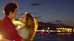 Beautiful happy young couple dating, looking on beautiful night city Stock Footage