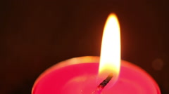 One burning candle close-up Stock Footage