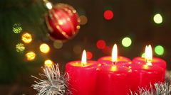 Candles in a silver tinsel garland in the background flashing. Christmas still l Stock Footage