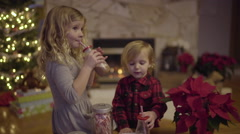 Little Kids Enjoy Hot Chocolate On Christmas Eve Stock Footage