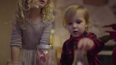 Little Boy Puts Marshmallows In Hot Cocoa, His Sister Jumps With Excitement Stock Footage