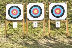 Three of paper archery targets in wooden stands Stock Photos