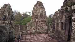 Ancient Sculpted Stone Structures at Bayon Temple in Cambodia Stock Footage