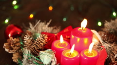Candles on the background of garlands blinking. Christmas still life Stock Footage