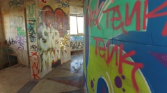 Abandoned building with paintings and graffiti in walls gimbal steady shot 4k Stock Footage