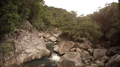 Wild Mountain Creek Tumbles along Rocky Course in Vietnam, with Sound Stock Footage