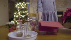 Little Girl Places Thank You Card To Santa Next To Hot Cocoa And Treats Stock Footage