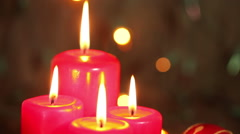 Burning candles and Christmas decorations. Christmas background Stock Footage