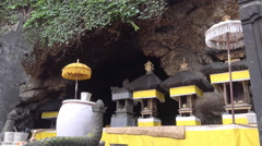 4k Indonesia holy bat temple cave entry Goa Lawah Bali close up zoom with bats Stock Footage